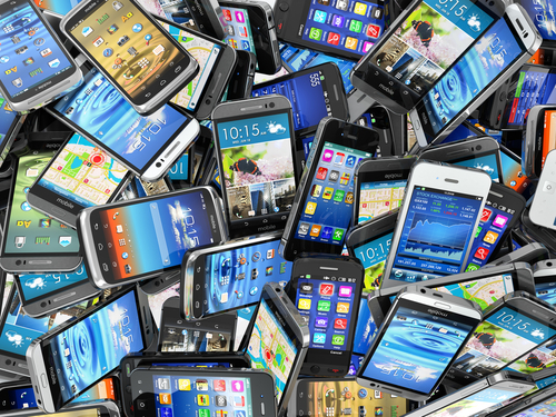mobile-phones-background-pile-of-different-modern-smartphones-3d-rcm992x0